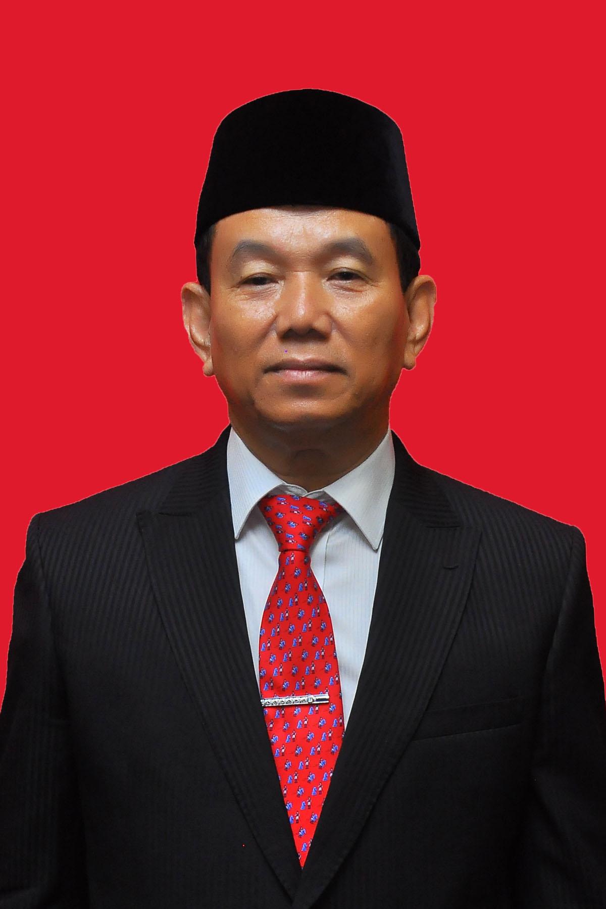 Drs. TUANI LUMBAN TOBING, M.Si
